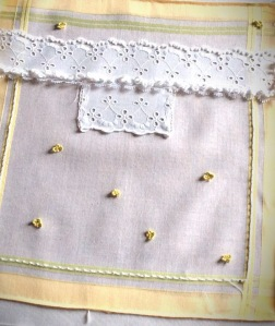 This is the first hankie, some lace, french knots and bullion stitch